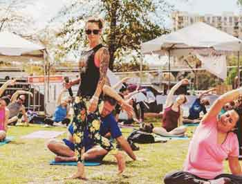 Photo of a Yoga Class outdoors.