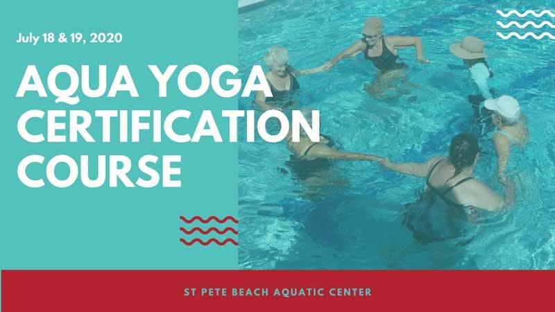 Photo of women in a pool during an Aqua Yoga class.